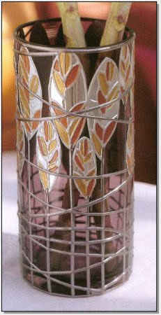 http://sdelaj.com/uploads/posts/2011-03/thumbs/www.sdelaj.com_vase_decorated_with_a_metal.jpg